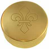 "Cap Box, 1-3/4"" diameter, embossed with ""fleur-de-lis"" engraving, polished brass, made in the U.S.A."